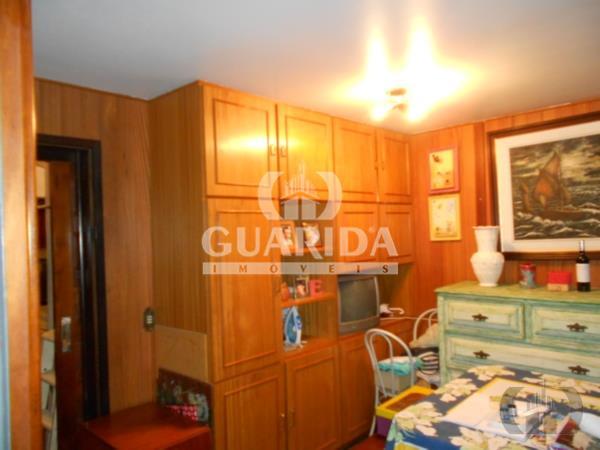 Casa de 4 dormitórios à venda em Auxiliadora, Porto Alegre - RS